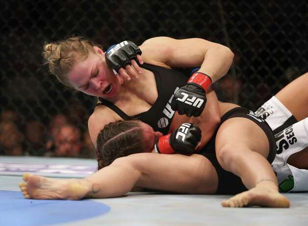 Ronda Rousey and Liz Carmouche made history just by stepping into the cage. When Rousey recorded another savage victory with her signature move, she demonstrated why she could be a trailblazer in women's sports for years to come. Photo: Jeff Gross, Getty Images / 2013 Getty Images