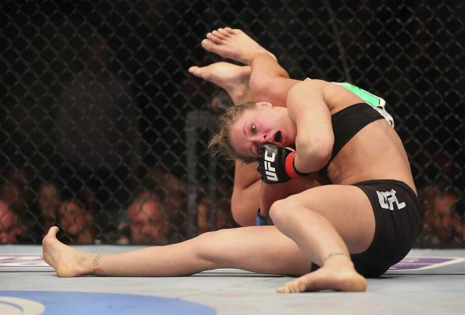 Rousey won the UFC's first women's bout Saturday night, beating Carmouche on an armbar with 11 seconds left in the first round of their bantamweight title fight at UFC 157. Photo: Jeff Gross, Getty Images / 2013 Getty Images