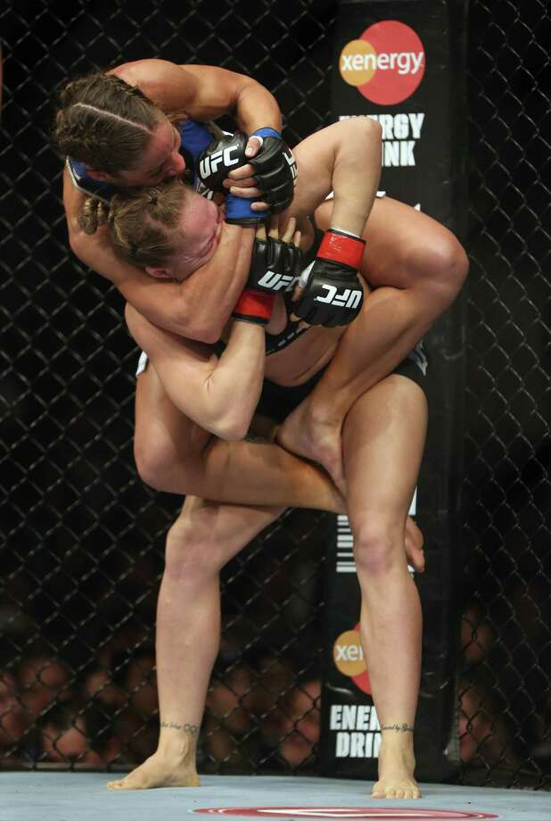 Liz Carmouche gets Ronda Rousey in a neck crank during their UFC Bantamweight Title fight at Honda Center on February 23, 2013 in Anaheim, California. Photo: Jeff Gross, Getty Images / 2013 Getty Images