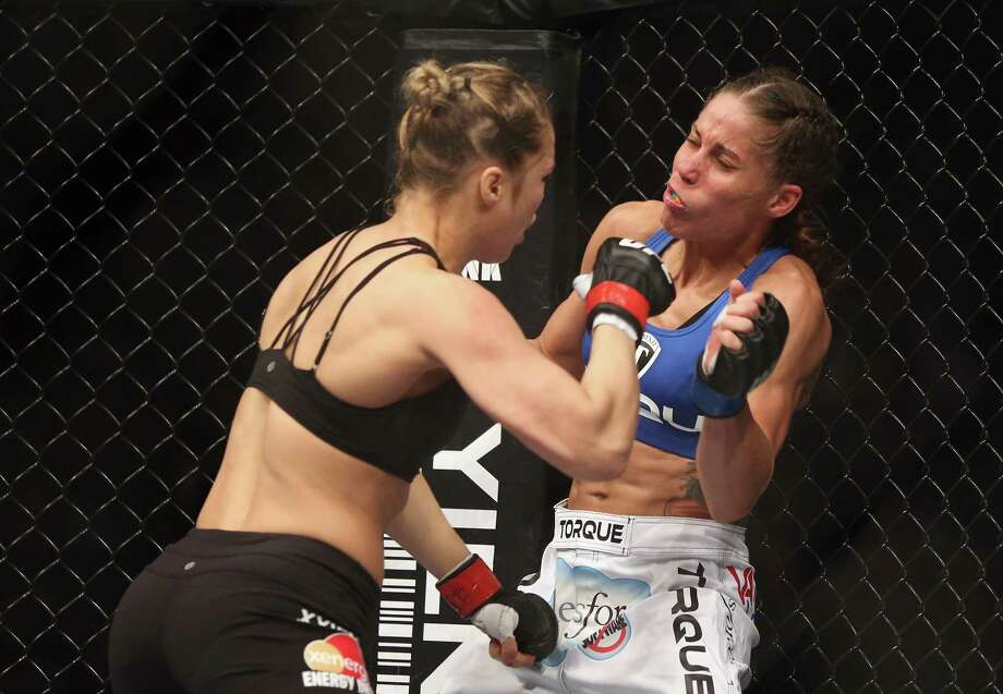 Ronda Rousey prepares to hit Liz Carmouche during their UFC Bantamweight Title fight at Honda Center on February 23, 2013 in Anaheim, California. Photo: Jeff Gross, Getty Images / 2013 Getty Images