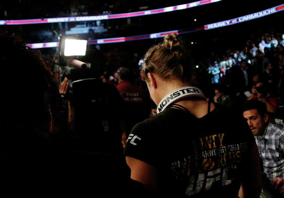 Ronda Rousey leaves after her UFC 157 women's bantamweight championship mixed martial arts match with Liz Carmouche in Anaheim, Calif., Saturday, Feb. 23, 2013. Rousey won by tapout in the first round. (AP Photo/Jae C. Hong) Photo: Jae C. Hong, Associated Press / AP