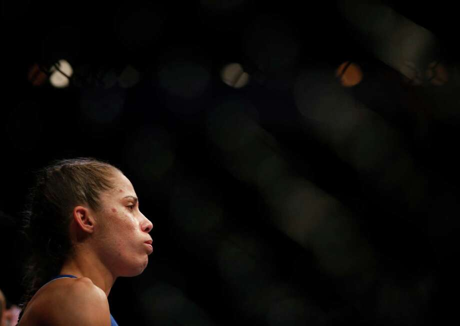 Liz Carmouche looks on before her UFC 157 women's bantamweight championship mixed martial arts match with in Anaheim, Calif., Saturday, Feb. 23, 2013. Rousey won by tapout in the first round. (AP Photo/Jae C. Hong) Photo: Jae C. Hong, Associated Press / AP