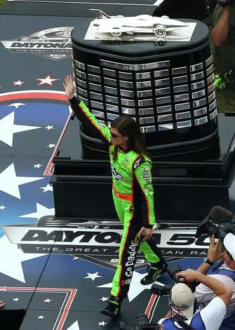 Danica Patrick, driver of the #10 GoDaddy.com Chevrolet, waves to the crowd during driver introductions. Photo: Jonathan Ferrey, Getty Images / 2013 Getty Images