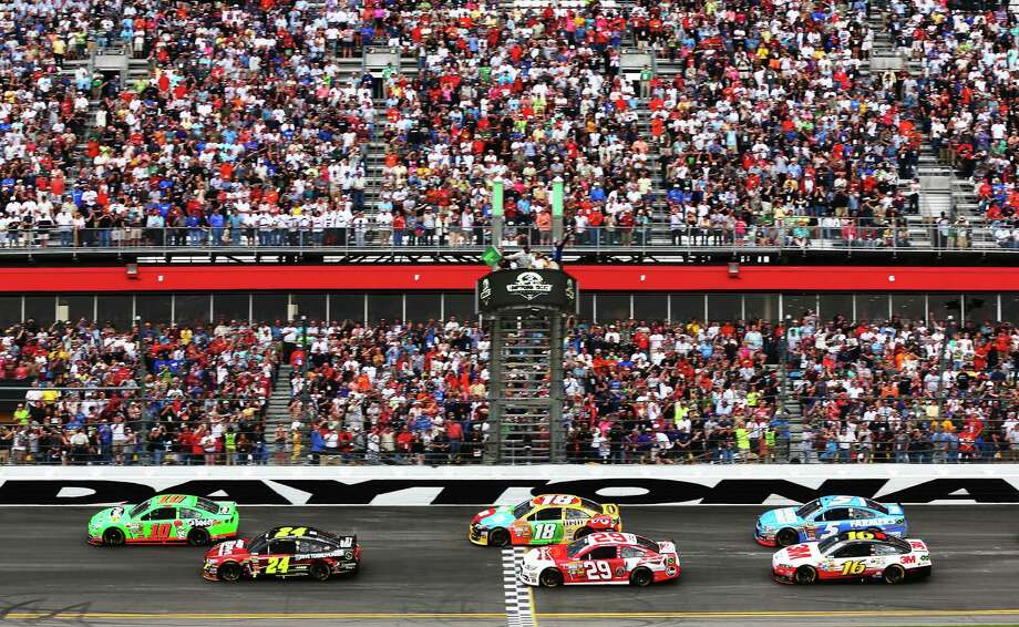 Danica Patrick, driver of the #10 GoDaddy.com Chevrolet, and Jeff Gordon, driver of the #24 Drive To End Hunger Chevrolet, lead the field past the green flag to start the NASCAR Sprint Cup Series Daytona 500. Photo: Mike Ehrmann, Getty Images / 2013 Getty Images