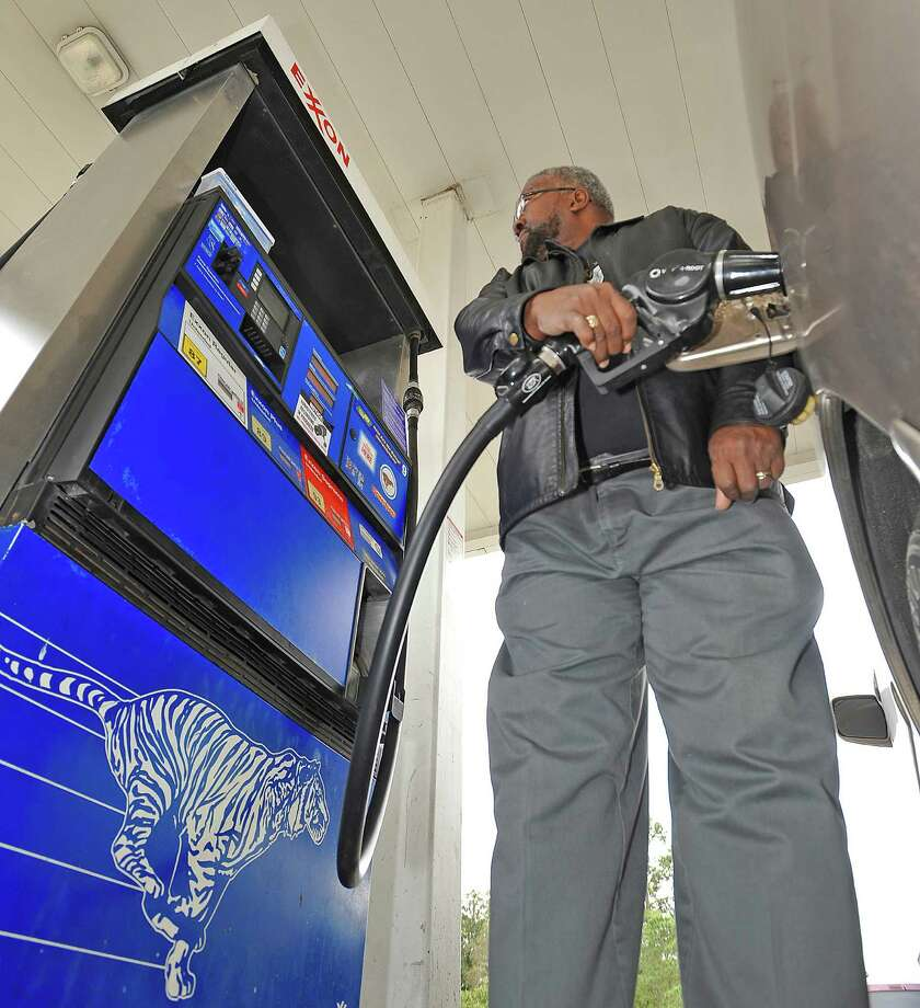 Gas prices are climbing again. Kelvin Moulton, a local buinessman, was topping off his tank Friday afternoon February 22, 2013 at a local Exxon/convience store in the west end of Beaumont between Calder and Phelan.   Dave Ryan/The Enterprise