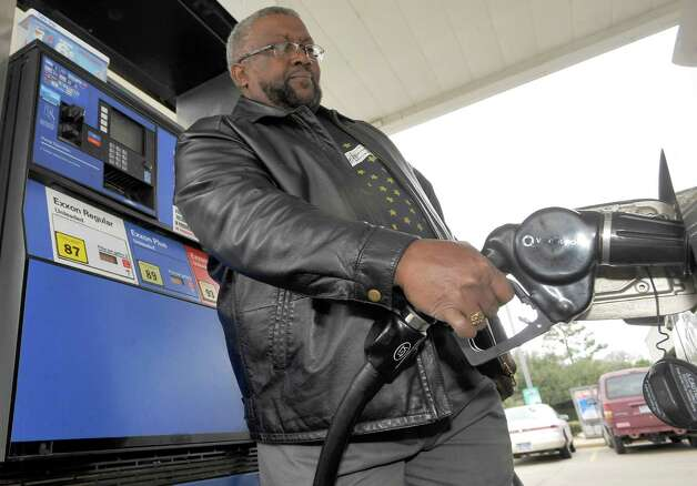 Gas prices are climbing again. Kelvin Moulton, a local buinessman, was topping off his tank Friday afternoon February 22, 2013 at a local Exxon/convience store in the west end of Beaumont between Calder and Phelan.   Dave Ryan/The Enterprise Photo: Dave Ryan