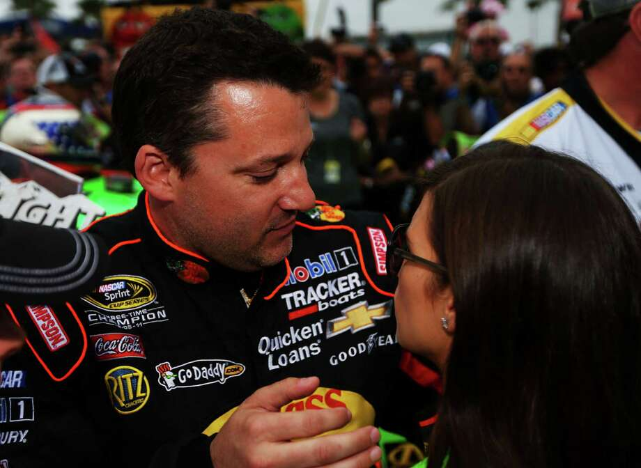 Tony Stewart, driver of the #14 Bass Pro Shops/Mobil 1 Chevrolet, talks to Danica Patrick, driver of the #10 GoDaddy.com Chevrolet, on the grid during pre-race ceremonies. Photo: Mike Ehrmann, Getty Images / 2013 Getty Images