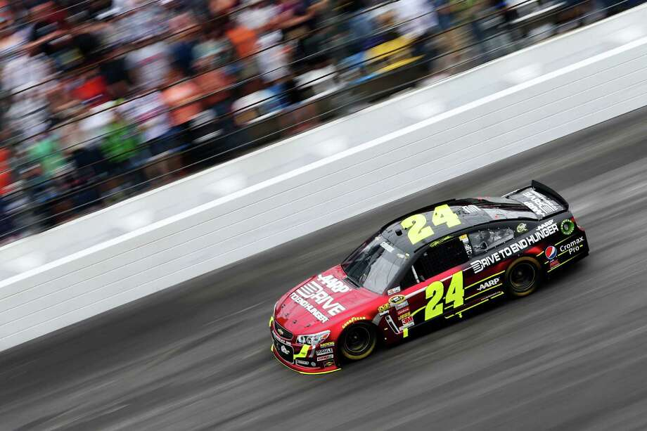 Jeff Gordon, driver of the #24 Drive To End Hunger Chevrolet, races during the NASCAR Sprint Cup Series Daytona 500. Photo: Matthew Stockman, Getty Images / 2013 Getty Images