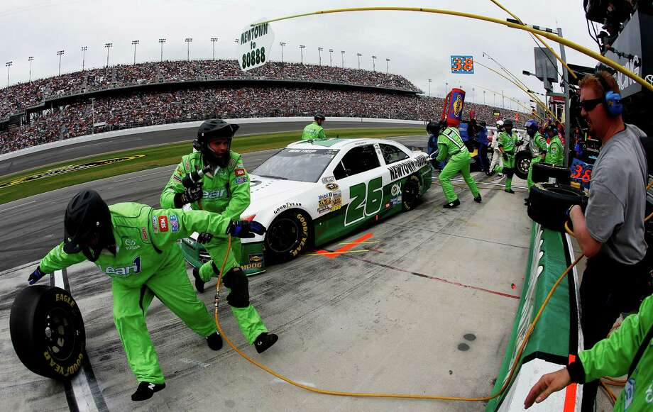 Michael Waltrip, driver of the #26 Sandy Hook School Support Fund Toyota, pits during the NASCAR Sprint Cup Series Daytona 500 at Daytona International Speedway on February 24, 2013 in Daytona Beach, Florida. Photo: Chris Graythen, Getty Images / 2013 Getty Images