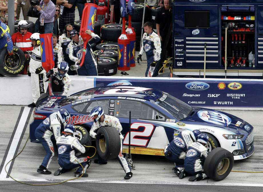 Brad Keselowski pits for fuel and tires during the NASCAR Daytona 500 Sprint Cup Series. Photo: David Graham, Associated Press / FR46423 AP