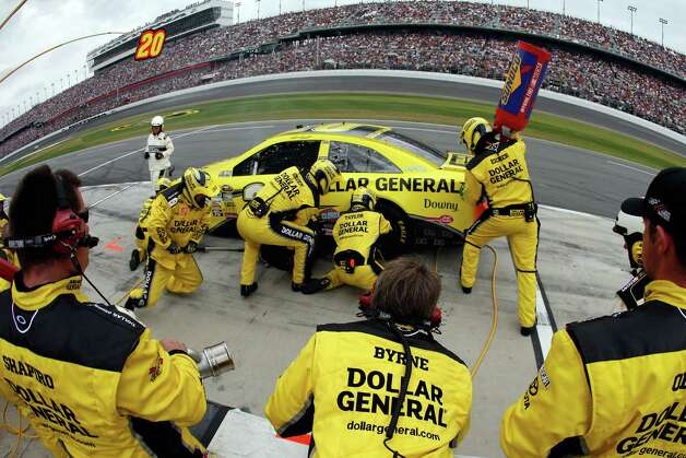 Matt Kenseth, driver of the #20 Dollar General Toyota, pits during the NASCAR Sprint Cup Series Daytona 500. Photo: Chris Graythen, Getty Images / 2013 Getty Images