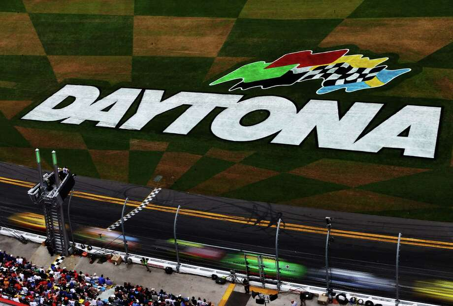 Drivers race  during the NASCAR Sprint Cup Series Daytona 500 at Daytona International Speedway. Photo: Jonathan Ferrey, Getty Images / 2013 Getty Images