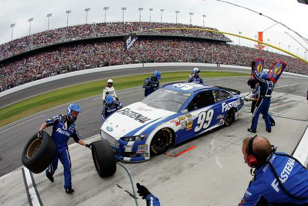 Carl Edwards, driver of the #99 Fastenal Ford, pits  during the NASCAR Sprint Cup Series Daytona 500. Photo: Chris Graythen, Getty Images / 2013 Getty Images