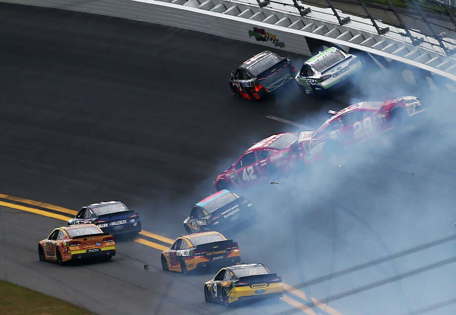 Juan Pablo Montoya, driver of the #42 Target Chevrolet, and Kevin Harvick, driver of the #29 Budweiser Chevrolet, are involved in an incident during the NASCAR Sprint Cup Series Daytona 500. Photo: Jonathan Ferrey, Getty Images / 2013 Getty Images