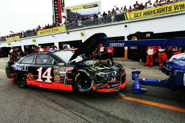 The #14 Bass Pro Shops/Mobil 1 Chevrolet, driven by Tony Stewart, is towed to the garage area following an incident during the NASCAR Sprint Cup Series. Photo: Mike Ehrmann, Getty Images / 2013 Getty Images