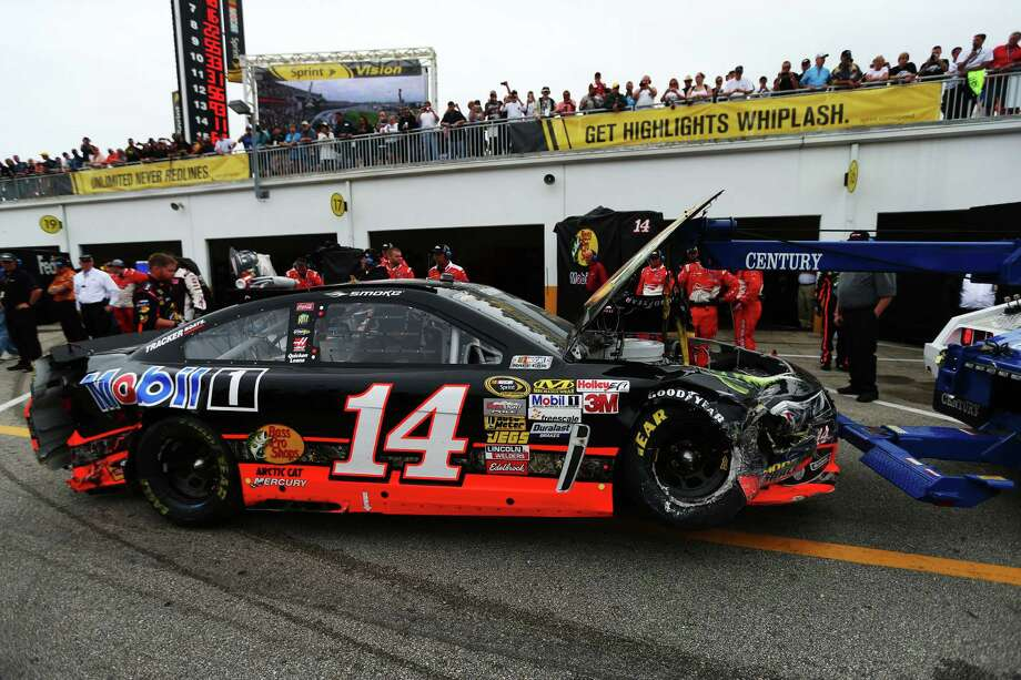 The #14 Bass Pro Shops/Mobil 1 Chevrolet, driven by Tony Stewart, is towed to the garage area following an incident during the NASCAR Sprint Cup Series Daytona 500. Photo: Mike Ehrmann, Getty Images / 2013 Getty Images