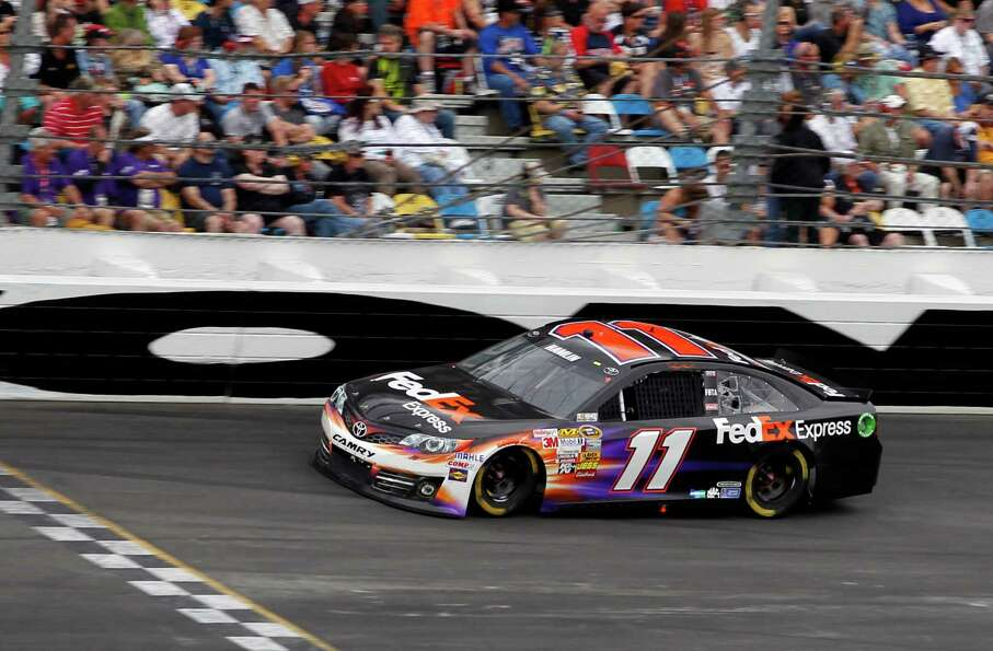 Denny Hamlin (11) competes in the NASCAR Daytona 500 Sprint Cup Series.