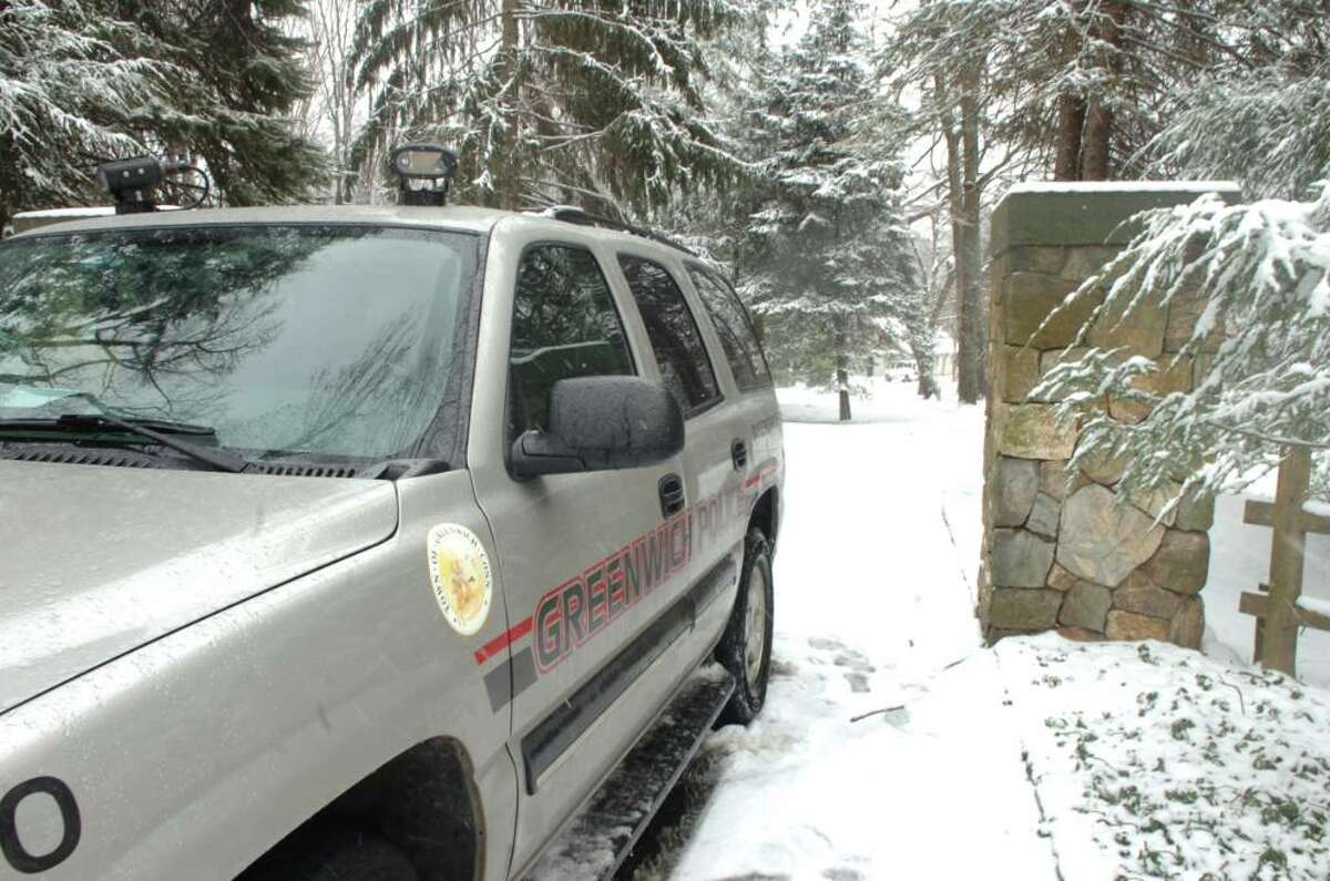 Greenwich, Dec. 31, 2009. A Greenwich police van parked in front of 100 Sterling Road where a murder has taken place. Adam Dobrzanski is charged in killing his daughter Amanda, and attempted to commit suicide.