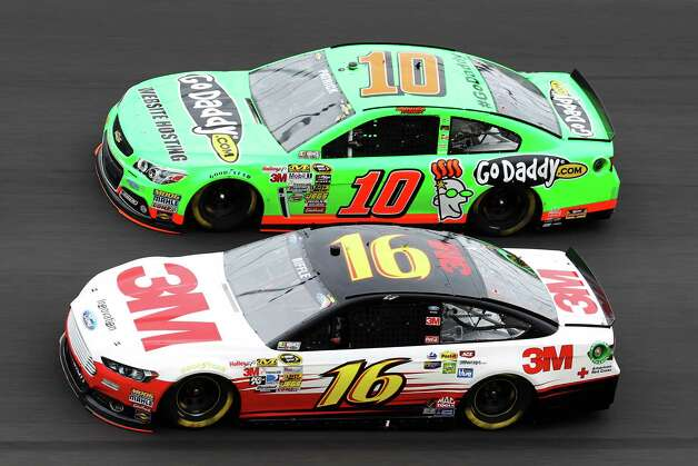 Greg Biffle, driver of the #16 3M FordMobil 1/Burger King, and Danica Patrick, driver of the #10 GoDaddy.com Chevrolet, race during the NASCAR Sprint Cup Series Daytona 500 at Daytona International Speedway on February 24, 2013 in Daytona Beach, Florida. Photo: Todd Warshaw, Getty Images / 2013 Getty Images