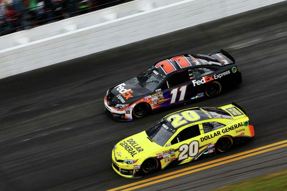 Matt Kenseth, driver of the #20 Dollar General Toyota, and Denny Hamlin, driver of the #11 FedEx Express Toyota, race during the NASCAR Sprint Cup Series. Photo: Matthew Stockman, Getty Images / 2013 Getty Images