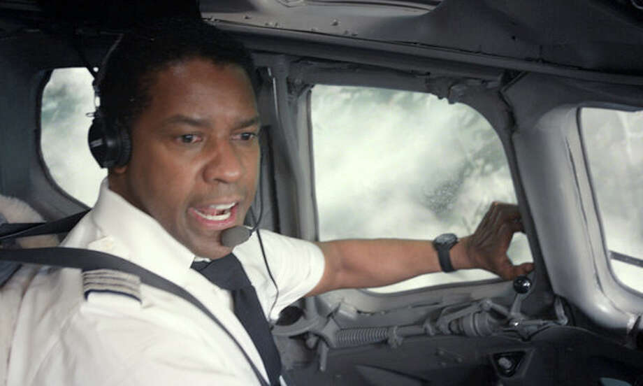 FLIGHT - It could very likely have been Denzel Washington strolling to the podium come Oscar night to collect his third Oscar (he has one lead and one supporting) instead of Daniel Day-Lewis if, you know, Daniel Day-Lewis wasn't there. Washington is that good as an alcoholic pilot whose ingenuity and booze-fueled quick thinking turn a doomed flight into miracle crash landing with minimal loss of life. And that's just the beginning. The character's descent into rock bottom is never less than acutely uncomfortable to watch, shockingly real and infinitely entertaining. What a winning return to live action for director Robert Zemeckis. As added bonuses you also get award-worthy turns from Kelly Reilly, James Badge Dale and the always overlooked John Goodman. / This photograph is protected by United States copyright law and may not be reproduced, distributed, transmitted, displayed, published or broadcast without the prior written permission of the copyright owner. Licensing requests should be sent to photosales@nytimes.com.