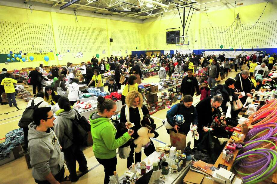 Parents and children from Newtown fill the gym at Reed Intermediate School in Newtown, Conn. and choose items during a give away of donated goods from the Sandy Hook Elementary School tragedy Sunday, Feb. 24, 2013. Photo: Michael Duffy / The News-Times