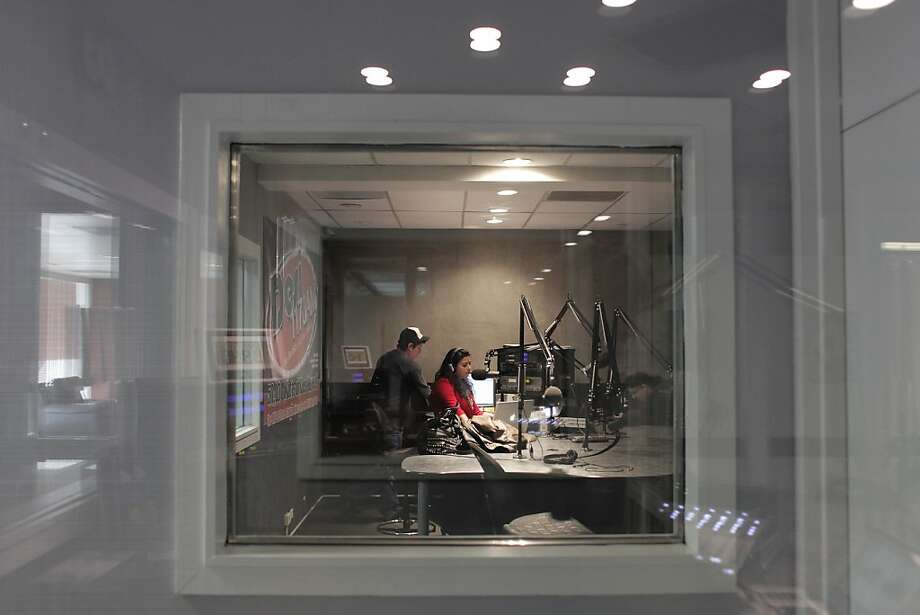 "Shreeja Sharma works with producer Nate Guevara on the ""Desi Superdrive"" morning show at San Jose's KLOK radio station. Photo: James Tensuan, The Chronicle"