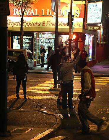 Pedestrians try to hail taxis at Polk and Pine streets on a busy weekend night. Photo: Liz Hafalia, The Chronicle
