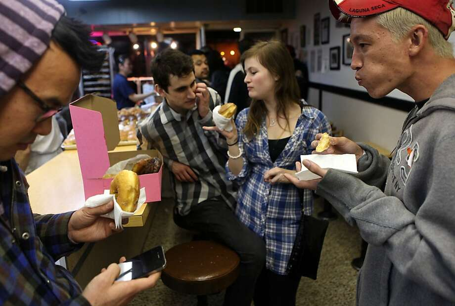 Joe Busto (l-r) from San Francisco, Eric Ortiz from San Diego, Moriah Biederman  from Los Angeles and Steve Johnson from Honolulu eat a box of donuts from Bob's Donuts on Polk St. in San Francisco, Calif., after going to Holy Cow and Vertigo on Friday, February 22, 2013. Photo: Liz Hafalia, The Chronicle