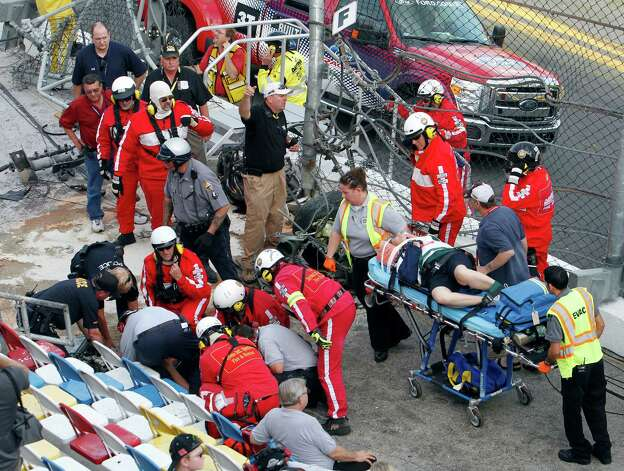 Injured spectators are treated after a crash at the conclusion of the NASCAR Nationwide Series auto race Saturday, Feb. 23, 2013, at Daytona International Speedway in Daytona Beach, Fla. Driver Kyle Larson's car hit the safety fence sending car parts and other debris flying into the stands. Photo: David Graham