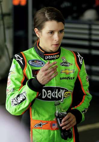 Driver Danica Patrick walks away from her car in her garage after she had engine problems and left the NASCAR Nationwide Series auto race at Daytona International Speedway, Saturday, Feb. 23, 2013, in Daytona Beach, Fla. Photo: John Raoux