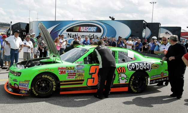 Danica Patrick's crew members push he car back to her garage after she had engine problems in the NASCAR Nationwide Series auto race at Daytona International Speedway, Saturday, Feb. 23, 2013, in Daytona Beach, Fla. Photo: John Raoux