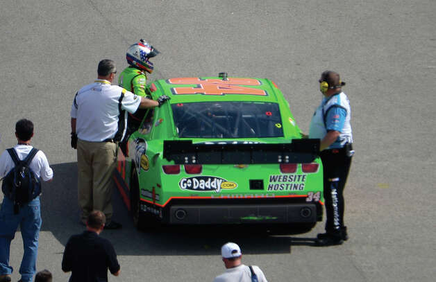 Danica Patrick gets out of her car near the garage area during a Nationwide Series auto race at Daytona International Speedway in Daytona Beach, Fla., Saturday, Feb. 23, 2013. Photo: AP