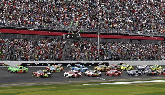 Danica Patrick (10) and Jeff Gordon (24) lead the pack to start the NASCAR Daytona 500 Sprint Cup Series auto race at Daytona International Speedway, Sunday, Feb. 24, 2013, in Daytona Beach, Fla. Photo: Terry Renna