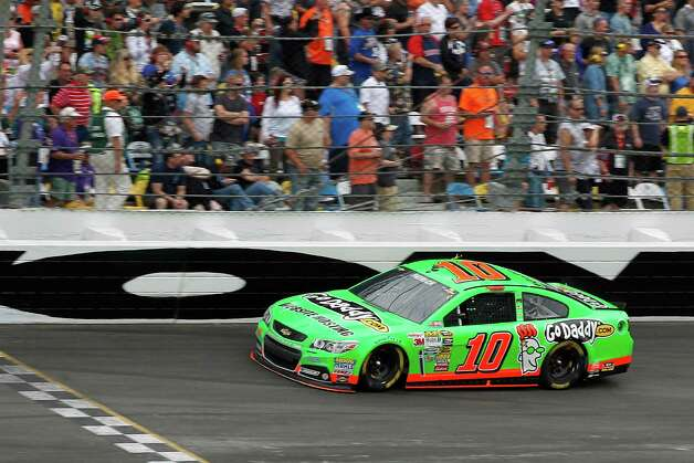 Danica Patrick competes during NASCAR Daytona 500 Sprint Cup Series auto race at Daytona International Speedway, Sunday, Feb. 24, 2013, in Daytona Beach, Fla. Photo: Terry Renna