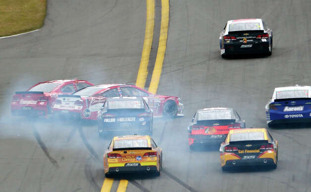 Juan Pablo Montoya (42) and Kevin Harvick (29) collide while going into Turn 1 during the NASCAR Daytona 500 Sprint Cup Series auto race at Daytona International Speedway in Daytona Beach, Fla., Sunday, Feb. 24, 2013. Photo: Phelan M. Ebenhack