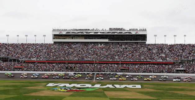 Drivers take the green flag at the start of the Daytona 500 NASCAR Sprint Cup Series auto race, Sunday, Feb. 24, 2013, at Daytona International Speedway in Daytona Beach, Fla. Photo: Chris O'Meara
