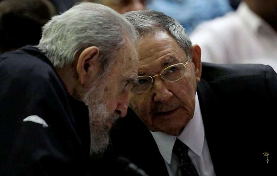 Revolutionary icon Fidel Castro (left) listens to his brother, current President Raul Castro, as Cuban lawmakers meet in Havana. The elder Castro drew cheers in a surprise appearance. Photo: Ismael Francisco, AFP/Getty Images