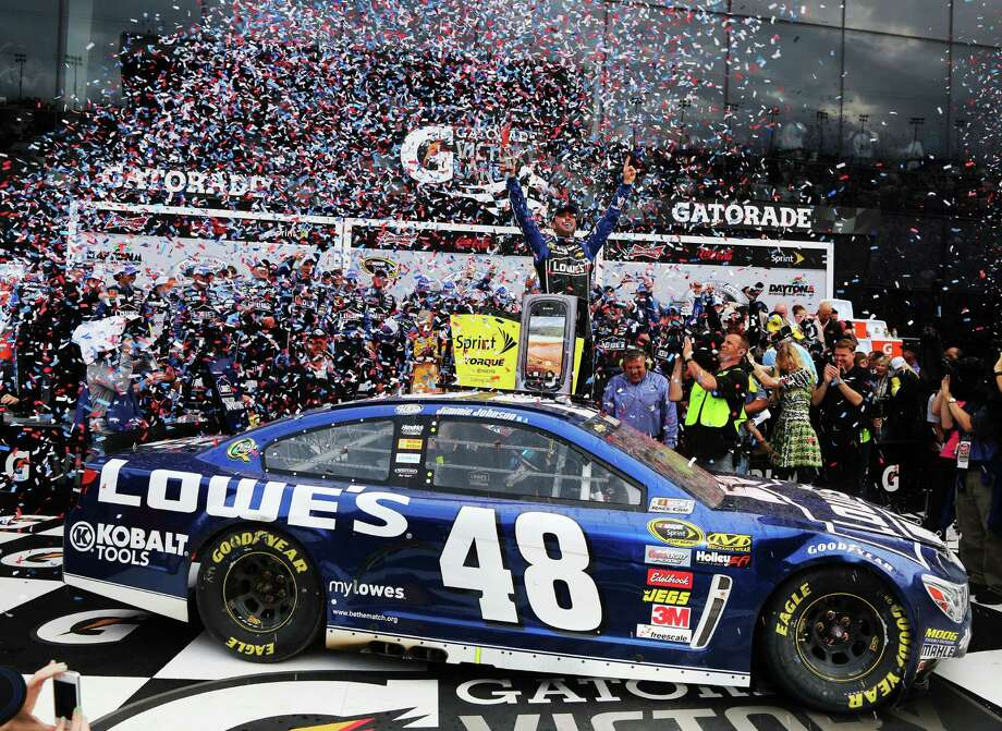 Jimmie Johnson, driver of the #48 Lowe's Chevrolet, celebrates in victory lane after winning the NASCAR Sprint Cup Series Daytona 500. Photo: Jerry Markland, Getty Images / 2013 Getty Images