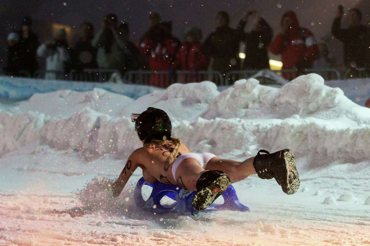 Topless female competitors wearing only panties prepare to compete in the 2013 naked snow-sledding competition on February 23, 2013 in Altenberg, Germany. The annual event, which this year drew thousands of spectators, is sponsored by a local radio station.
