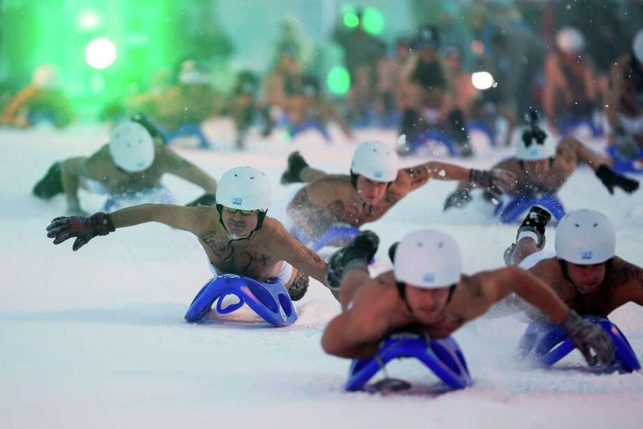 Competitors wearing only underwear and panties ride a sled in the 2013 naked snow-sledding competition on February 23, 2013 in Altenberg, Germany. The annual event, which this year drew thousands of spectators, is sponsored by a local radio station. Photo: Joern Haufe, Getty / 2013 Getty Images