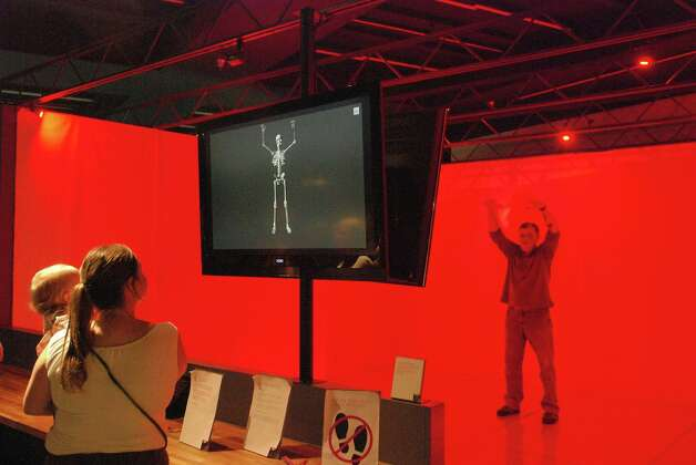Visitors check out an interactive exhibit about the art of animation at The Leonardo, a contemporary science, technology and art museum in Salt Lake City. Photo: San Antonio Express-News