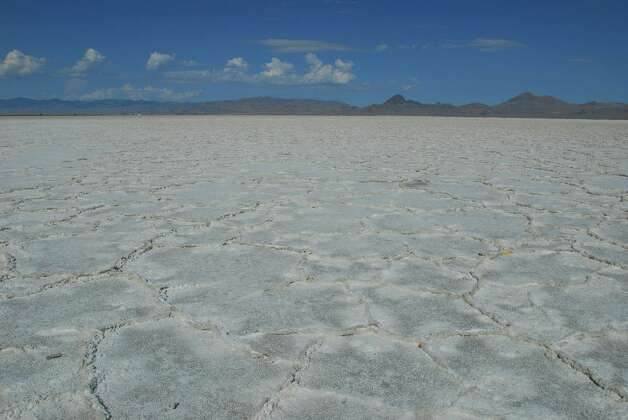 A patchwork quilt of salt formations coats the ground at Utah's Bonneville Salt Flats. Photo: San Antonio Express-News