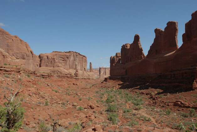 A look at the tall red cliffs and variety of formations in Arches National Park might evoke memories of old Westerns in movie theaters and on TV -- the first place many catch a glimpse of the rugged landscape in Utah. Photo: San Antonio Express-News