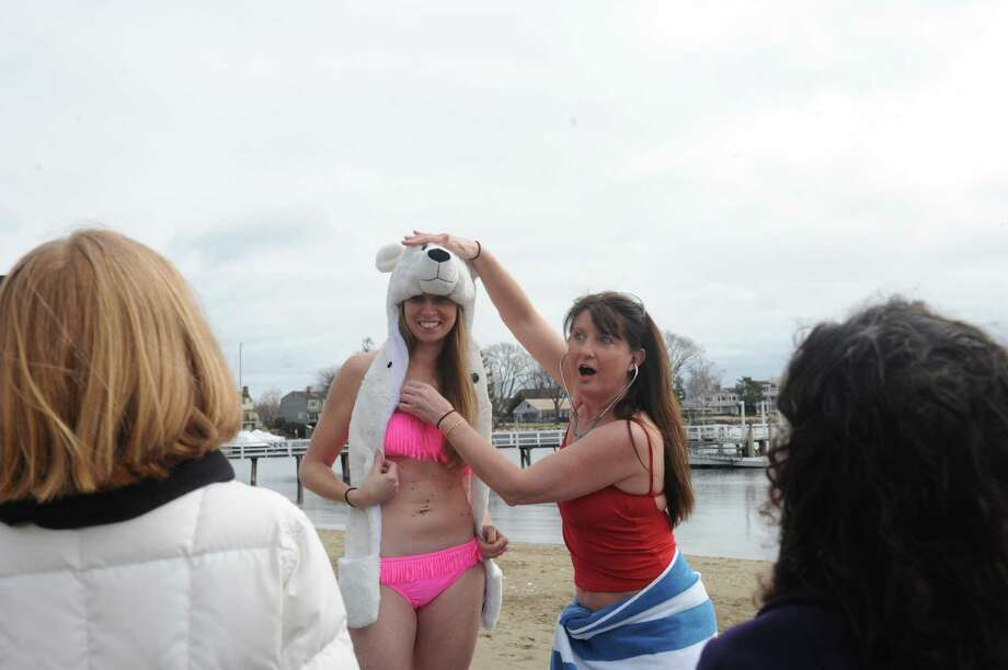 Sarah Timko, of Fairfield, a lifegard, left, and Staphanie Daly, Stamford, a nurse, met at the  Family Centers of Greenwich's, second annual Polar Bear Plunge in the Long Island Sound at Geneve Holdings, in Stamford, Conn., Sunday, Feb. 24, 2013, to benefit The Den for Grieving Kids, a Family Centers program. Photo: Helen Neafsey / Greenwich Time