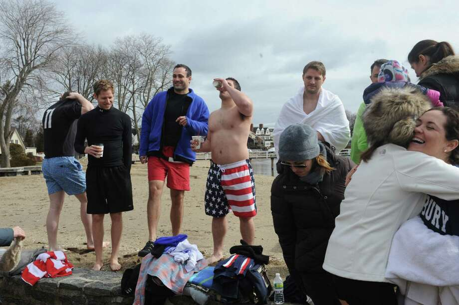 Guests get ready for the Family Centers of Greenwich's second annual Polar Bear Plunge in the Long Island Sound at Geneve Holdings, in Stamford, Conn., Sunday, Feb. 24, 2013, to benefit The Den for Grieving Kids, a Family Centers program. Photo: Helen Neafsey / Greenwich Time