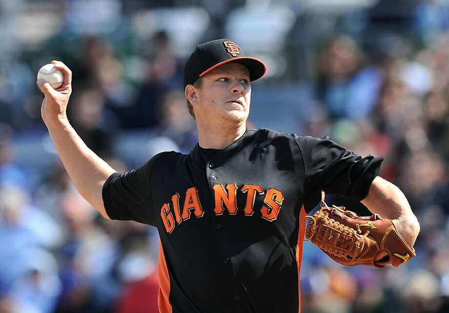 MESA, AZ - FEBRUARY 24:  Matt Cain #18 of the San Francisco Giants delivers a pitch against the Chicago Cubs at HoHoKam Park on February 24, 2013 in Mesa, Arizona.  (Photo by Norm Hall/Getty Images) Photo: Norm Hall, Getty Images