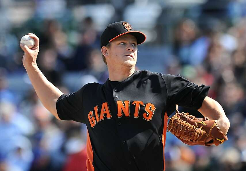MESA, AZ - FEBRUARY 24:  Matt Cain #18 of the San Francisco Giants delivers a pitch against the Chic