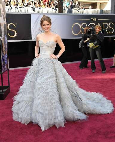 Worst: Amy Adams has the fashion world at her feet, and she picks the pigeon dress? Photo: John Shearer, Associated Press