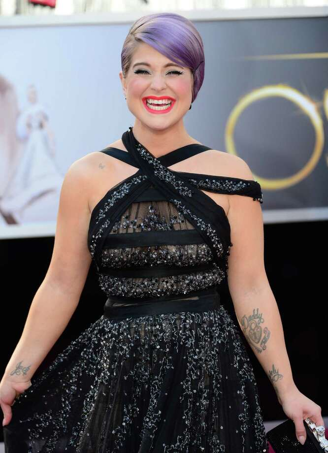 Worst: Kelly Osbourne: Bondage. Demure French twist. Pick one. Photo: FREDERIC J. BROWN, AFP/Getty Images / AFP